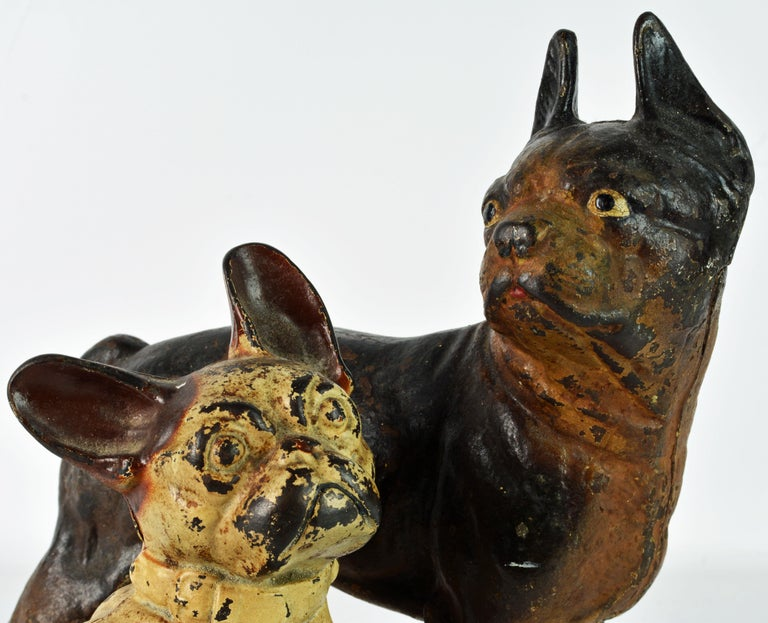 Two Charming Early 20th Century Painted Cast Iron Door Stop Dogs In Fair Condition For Sale In Ft. Lauderdale, FL