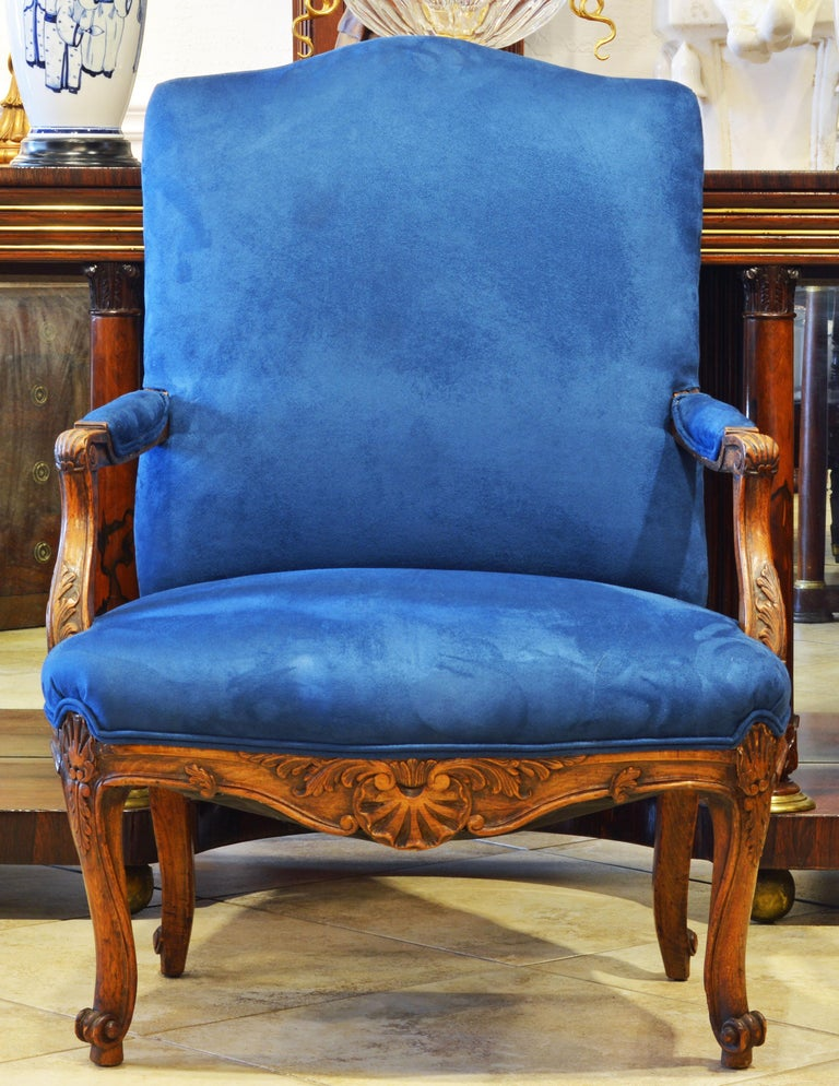 Of generous proportions these 19th century French Provincial armchairs feature carved armrests, elaborately carved and shaped aprons and carved cabriole legs all fashioned in the style of Louis XV. They are recently reupholstered and covered in an