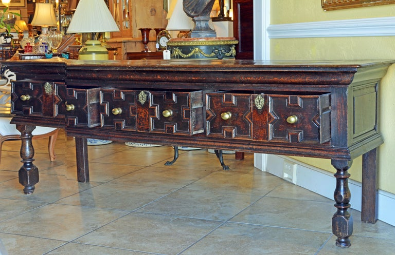 Rarely do we see furniture of this age in such good condition. Some restorations and repairs have naturally taken place during its long lifespan but the overall impression is that of authenticity. The dresser features a two plank top and molded