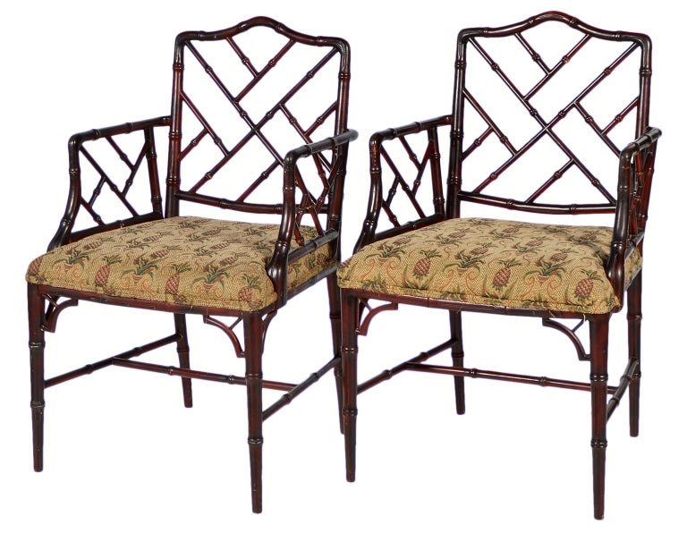 In the Classic Palm Beach style this pair of iconic armchairs feature an open framework in the Chinese Chippendale tradition with upholstered seats covered by a beautiful pineapple pattern fabric.