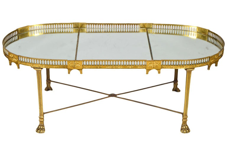 This early 19th century French gilt bronze plateau or 'surtout de table' features mirrored surfaces surrounded by an architecturally styled gallery of great ornamental detail. The plateau rests on a later neoclassical style bronze stand with paw