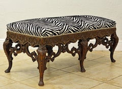 Late 19th Century Richly Carved Louis XV Style Bench with Zebra Print Cover