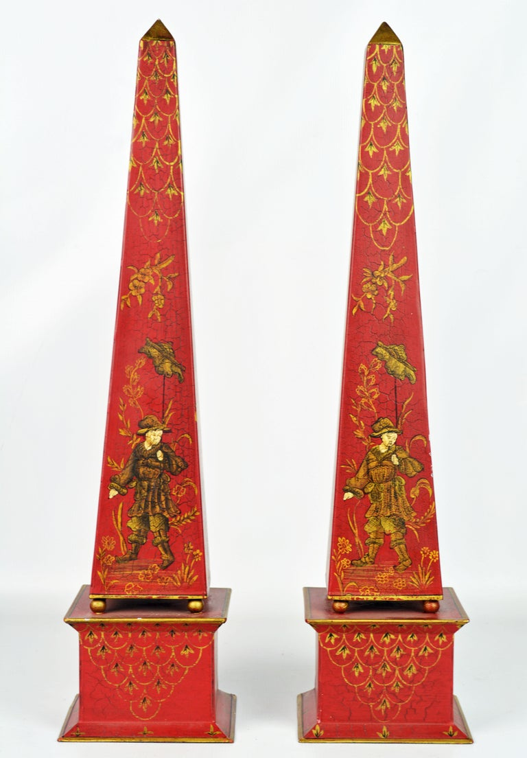 Standing 22 inches tall and painted in the Chinese taste on a Venetian red background these obelisks make a fashionable statement.