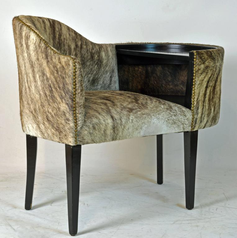 Elegantly shaped this unique piece of likely French furniture features a strikingly beautiful overall cover and ebonized table with underlying shelf resting on four tapering square legs.