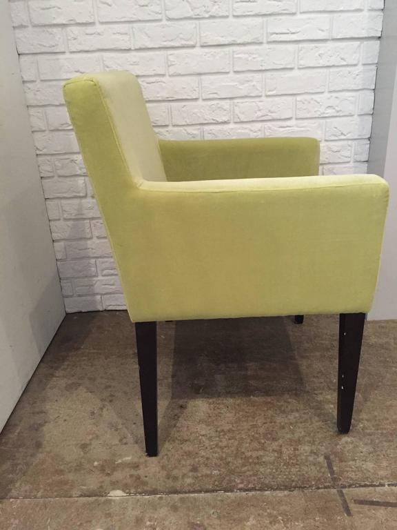 Pair of modern Dining Arm Chairs with slender wood legs. Recently reupholstered in a citrus lime Rogers and Goffigon velvet.  The chairs are versatile enough to work as occasional seating in the a Living Room or Library as well as serve as Host/ess