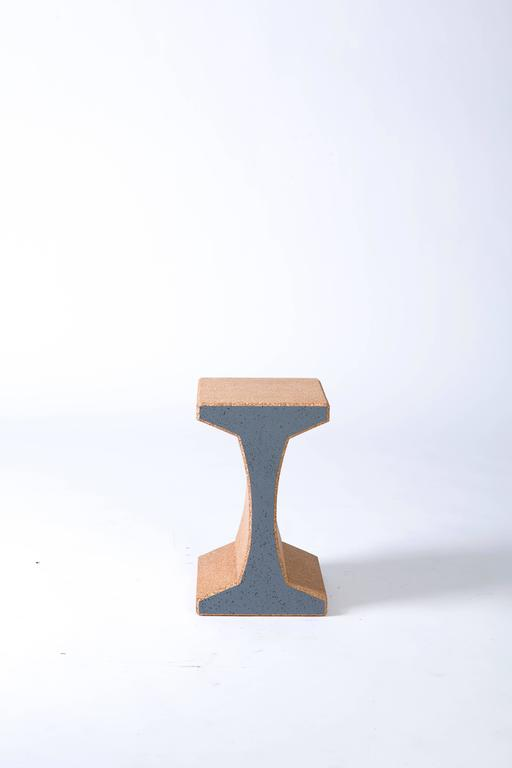 The I-Beam, which can function as either a side table or a stool, is made from solid blocks of recycled cork and reinforced with steel rods for added durability.  It can be stacked horizontally for a unique and highly functional bookshelf.  Its