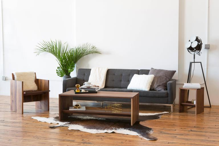 This sturdy coffee table is made entirely out of solid walnut slabs and precision joinery.  Rugged yet refined, the coffee table's durable and liquid/impact resistant hardwood surface can walk away unscathed from even your most brutal living room