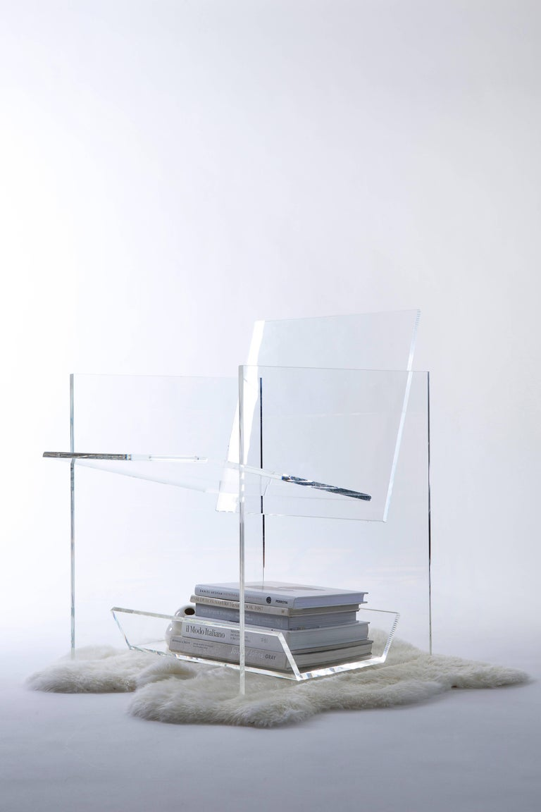 """The foundational piece of the Bond Series is the armchair, formerly known as the """"Cactus Chair,"""" a transparent acrylic chair that houses a barrel cactus beneath the seat, inspired by the classical cartoon trope of the villain falling on a cactus."""