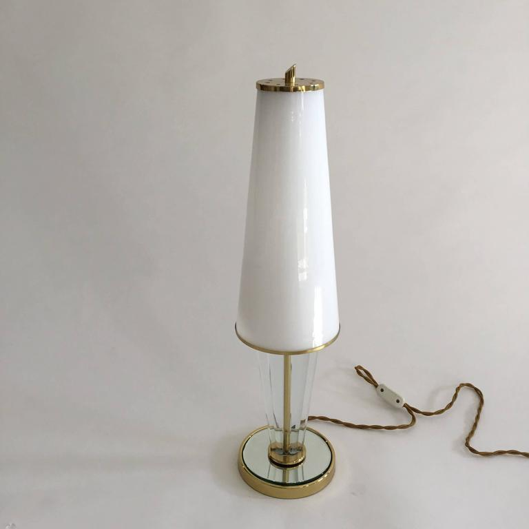 Pair of table lamps, golden base with central mirror, made by Brusotti, Italy, 1940s.  Size: 14.5 x H 61cm.