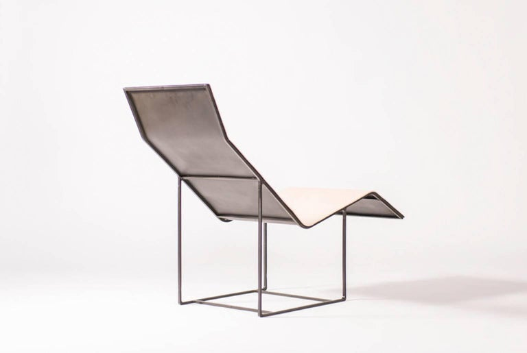 Chaise by Klein Agency.  A luxurious modern chaise in leather and steel.   The chaise is quite literally our long chair. With its many uses, it can serve well as an outdoor deckchair, a sun-lounger, or as part of an elegant, indoor living room.