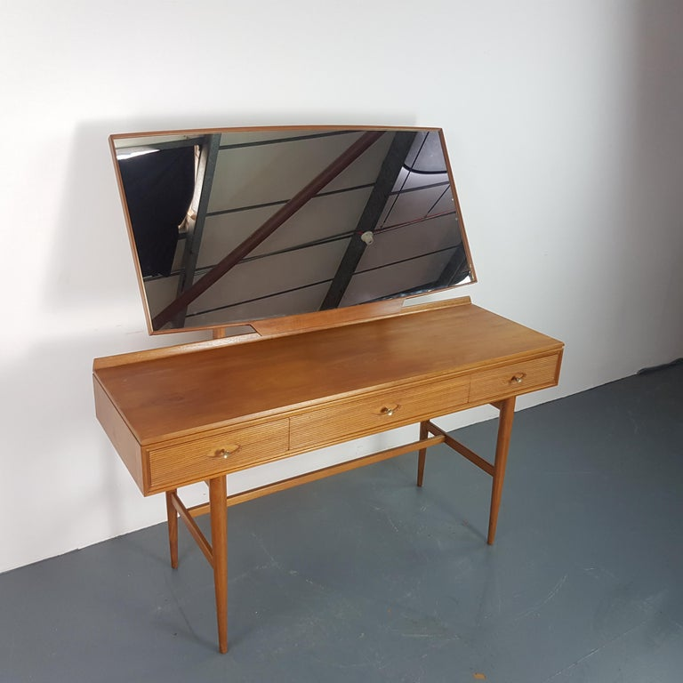 Vintage midcentury teak dressing table / desk by Robert Heritage for Archie Shine  In good vintage condition.  Approximate dimensions:  Width: 137cm  Depth: 47cm  Height: 137cm (to top of mirror)  Drawers 34 x 36 x 8 cm 55 x 36 x 8 cm
