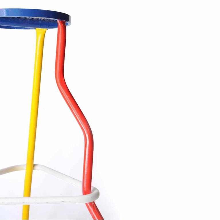 Pair of bar stools. Structure made in tubular steel lacquered in white, yellow, red and Klein blue. Die-cutting seat. France, 1970.
