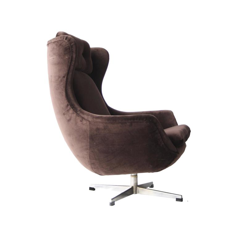 Fritz Hansen style armchair with cotton tercipel upholstery and brushed steel foot.