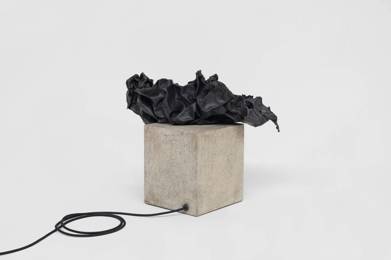 Table lamp made of concrete and lead.