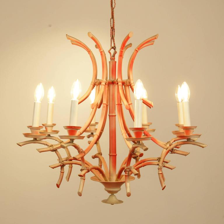 Vintage italian faux bamboo chinese chippendale style pagoda italian coral painted bamboo chandelier the chandelier has eight arms and lights and a classic audiocablefo