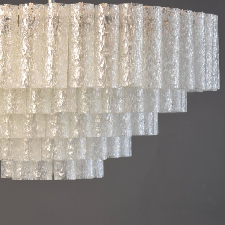 This large five-tire crystal chandelier by Doria was manufactured circa 1960 in Germany. It has Murano glass tubes. This is very rare. Normally it comes with four tires.