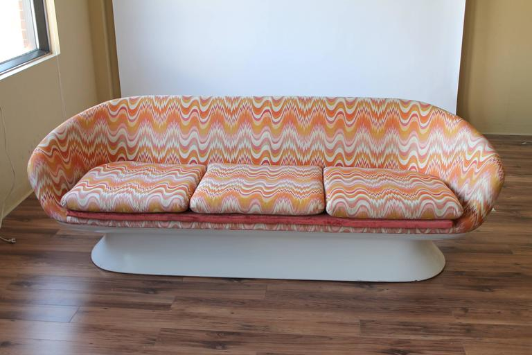 Ergonomicaly designed and very comfortable.  Base is made of enameled fiberglass.  Reupholstered  by previous owner  .  7 feet wide by 28.5 inches high .