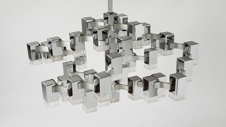 In very good condition.   Prime quality material, solid construction, fine assembly and craftsmanship.  Brass cubes covered by a thick chrome coat.   Bridge between the cubes are made of aluminium.   A pull down and push up mechanism move