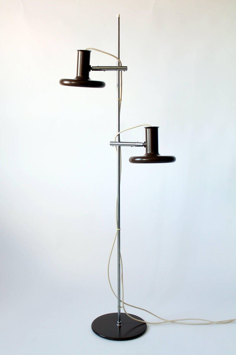 Danish iconic Minimalist floor lamp in a dark chocolate brown tone.  Shades slide up and down anywhere on chrome pole and pivot in all direction.  Well made and sturdy hardware.  Height is 56 inches, base of lamp is 10 inches wide.  Ceramic