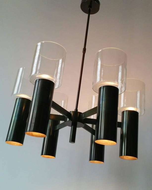 Massive anodized metal structure, topped by six mouthblowed clear thick glass shade.  Regular E26 North American medium size socket. Rated at 60 watts each.  Six upward and six downward firing light bulbs.  Oxydation (patina) created by heat