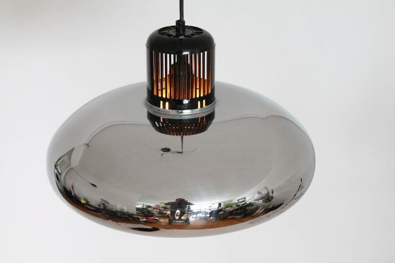 Minimalist , thick deep chrome quarter bell chandelier.   A nicely designed bakelite vented hat top it off.   The inside is enameled white.  Measures: 16 inches wide by 10 inches high.  Stilnovo stamped on bakelite and sticker inside.