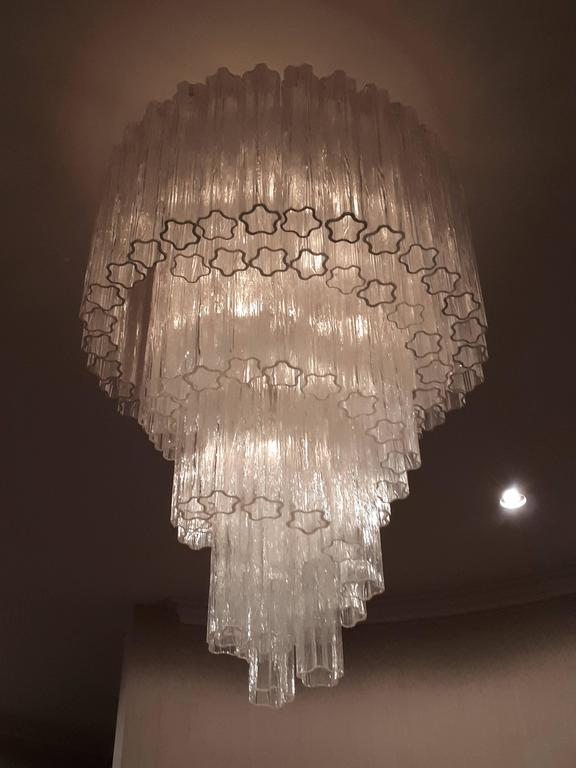 Original huge sculptural chandelier made of thick texturized  clear glass pieces .  Each shade measure 16 inches in lenght .   Frame is enameled bone  white.   Measure 52 inches high by 31 inches wide.   Contain 10  regular size E26 ceramic socket