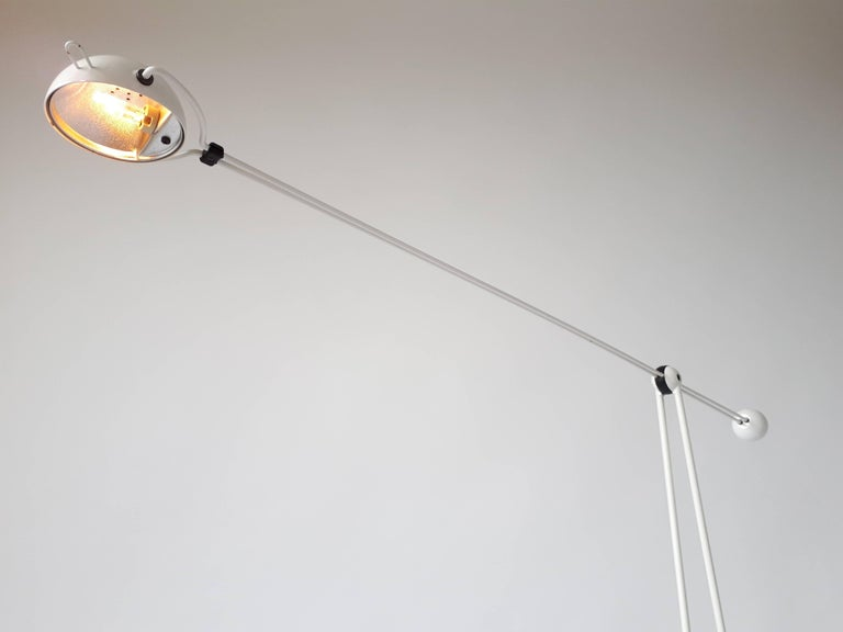 Minimalist, modern, tall and elegant counterweight halogen floor lamp designed in 1983 by Paolo Francesco Piva.