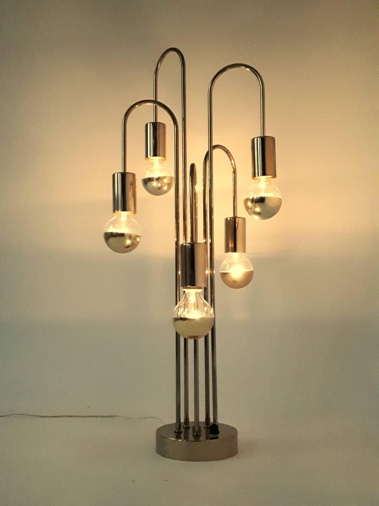 Tall sculptural table lamp with accurate dimmer on base.   Solid, well made with prime quality material.   Measure 35 inches high.   Five regular E26 ceramic socket rated at 60 watt each.  Pictured here with gold top light bulb , not supplied with
