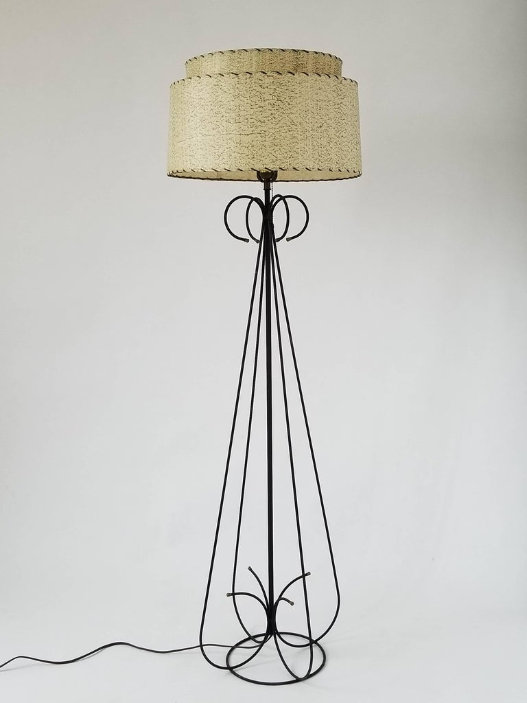 Structure made of enameled steel wire.   Contain one E26 size socket rated at 100 watt max.   On/off pull chain   Fiberglass shade supplied with order. Measure 17.5 in wide x 10 in. high.   Lamp with shade measure 59 inches high.