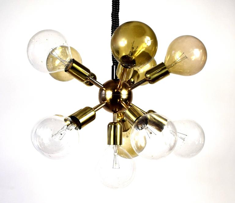Very high quality chandelier. Material: gold-plated brass. 11 Globe bulbs with 125 mm diameter (not included in offer).  Adjustable height (circa 80-130 cm) Excellent condition.  Diameter: 60 cm (incl. bulbs)  I can also offer suitable bulbs