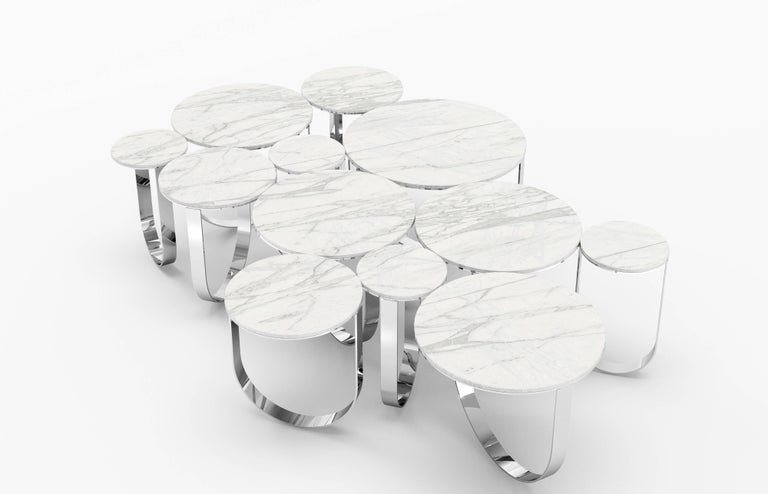The 'Cloud' is a spectacular coffee table with structure in mirror polished stainless steel and top in statuary marble (origin: Tuscany). Coffee table dimension: L 163 x W 107 x H 38cm. The mirror-like finishing of the stainless steel creates