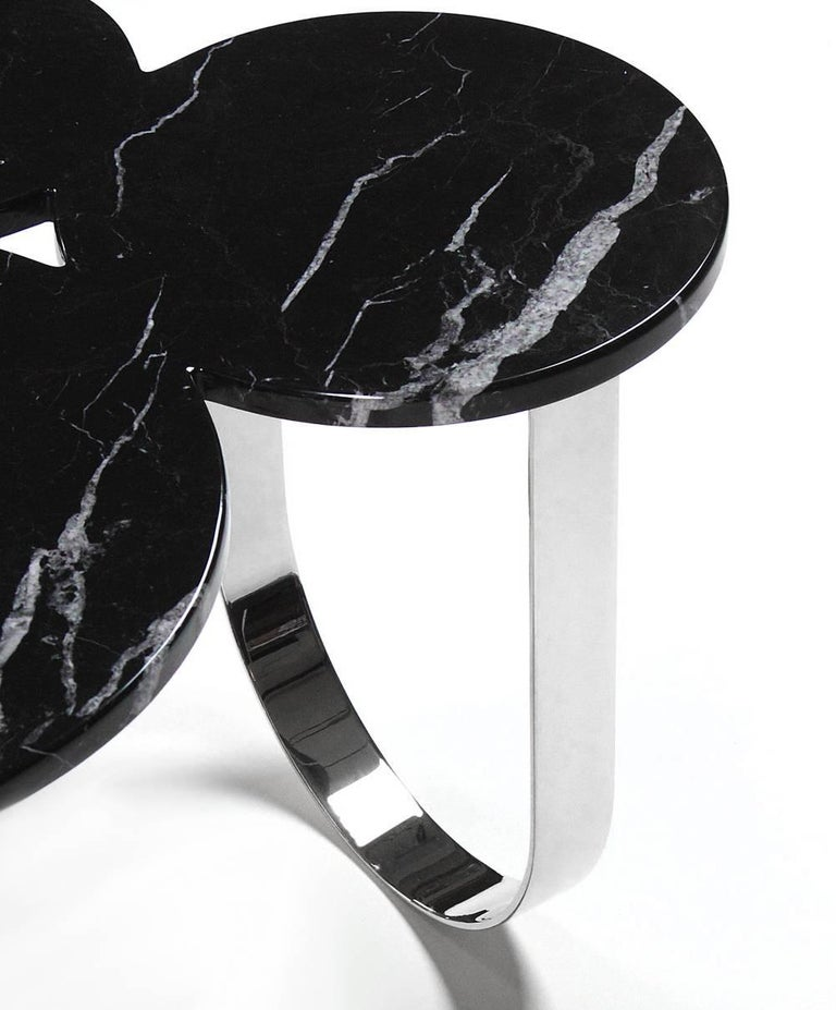 The 'Cloud' is a spectacular side table with structure in mirror polished stainless steel and top in Marquinia marble. Side table dimension: L 65 x W 52 x H 55cm. The mirror-like finishing of the stainless steel creates different perceptions of this