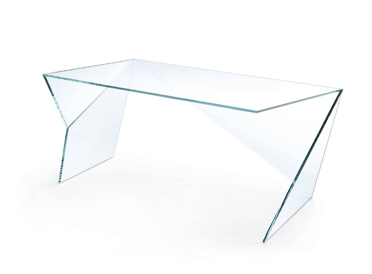 The executive desk 'Origami' is made of crystal glass. Side table dimension: L 195, W 93, H 75 cm. The inspiration for origami came from the observation of a simple piece of paper which, being folded a few times according to an antique Japanese