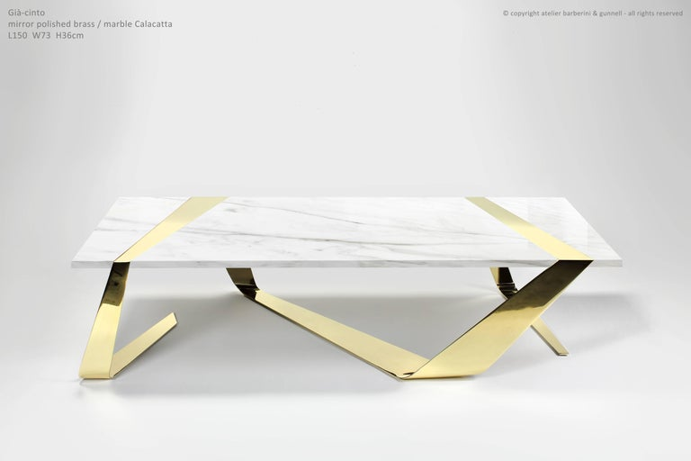 The ribbon made of brass hugs and supports the precious marble at the same time. Coffee table dimension: L 150, W 73, H 36cm. Each table is hand signed and numbered by the artists - technique: engraved. 100% handmade in Italy, comes with a