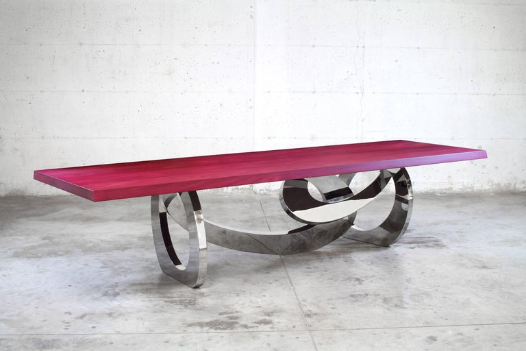 The table bangles is an important dining table with structure in mirror polished stainless steel and top in Amaranth solid wood. Dining table dimensions: L 250-350 x W 115 x H 76 cm. Dimensions are customizable. Every single bangle is welded and