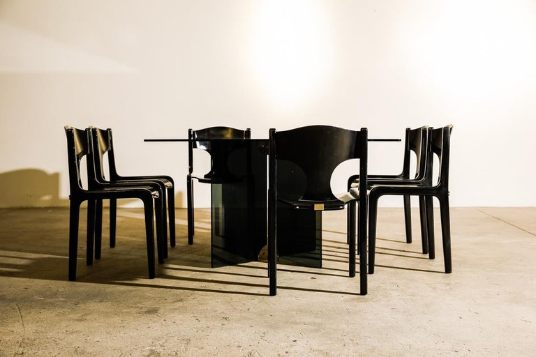 Rare set of 12 chairs which were first presented at Galleries LaFayette by Pozzi in 1968. Like all work from Savini they are characterized by their refined simplicity.