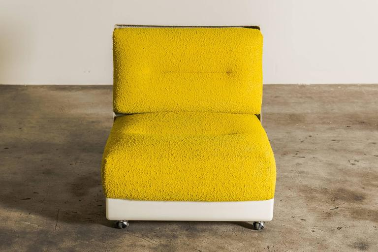 Rare set of two lounge chairs by Saporiti Italy in original upholstery. Designed by Vittorio Introini for Saporiti 1968. The frame is made from single moulded fibreglass. Highly comfortable easy chairs.
