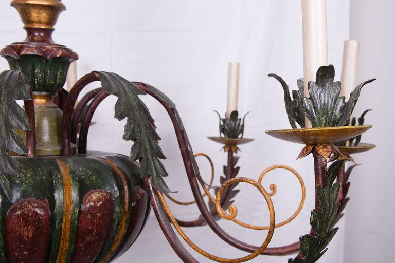 Beautifully carved, electrified eight-light Italian polychrome chandelier. Tole arms, bobeches and decoration.