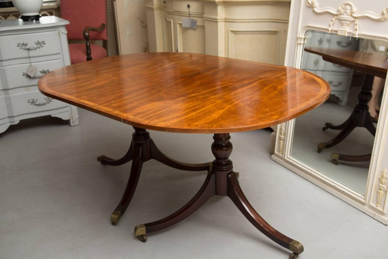 20th Century English George III Style Mahogany Twin Pedestal Mahogany Oval Dining Table For Sale