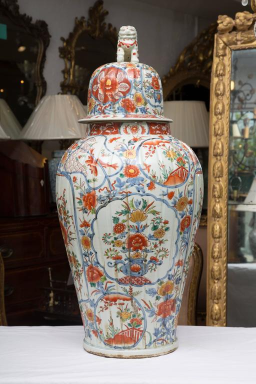 These magnificent Chinese palace lidded urns offer a soft palette of blues and bittersweet floral sprays and other naturalistic decoration. The design incorporates floral sprays within various medallion shapes . The urns are flutted and lidded with