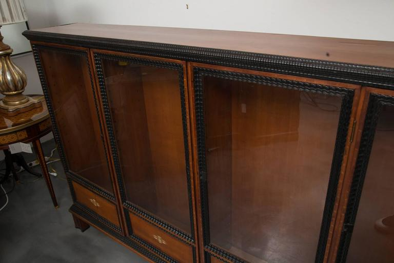Hand-Carved 19th Century English Regency Style Cherry and Ebony Bookcase For Sale