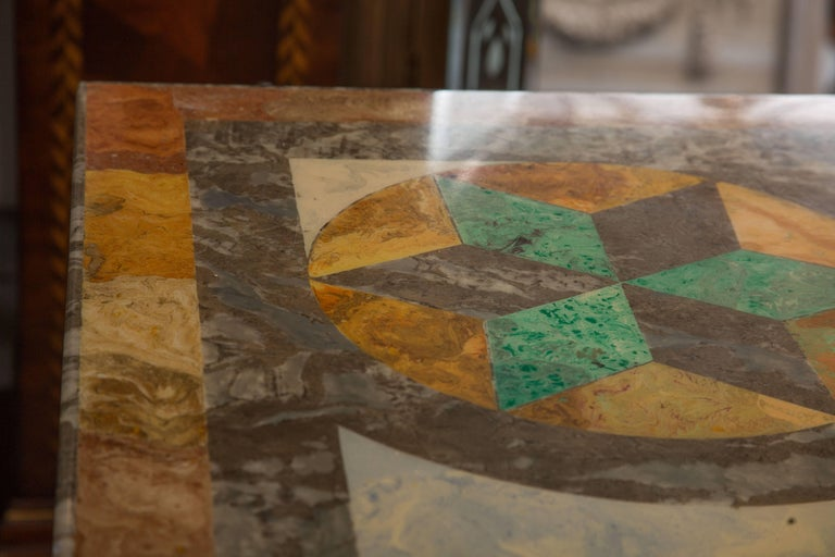 This exquisite Italian Scagliola marble table has architectural geometric patterns painted on the surface and is supported by two corabel form plinths naturalistically textured, circa 20th century.