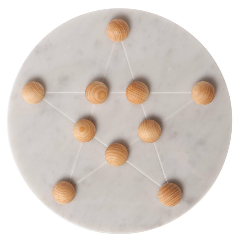 Not satisfied of just being able to hold ten candles, Cornelius has a second purpose as a Pentalpha game. Using ten marbles in Cypress wood, one can play an intriguing game. Cornelius even takes it two steps further also serving as a table