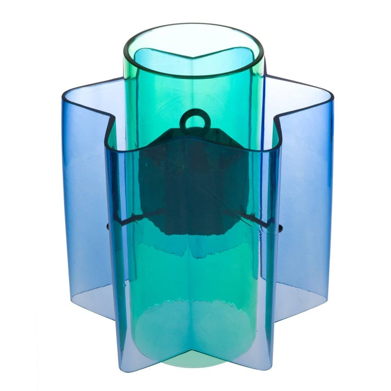 Inspired by children's educational toys, two basic shapes in primary and secondary colors, combined become a complex shape with a dazzling color effect: looking through both shapes a tertiary color appears. Mouth blown by master craftsmen in