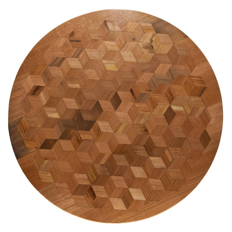 Inspired by the work of Escher, with Maurits we want to prove that a table doesn't have to be antique to be an impressive testimony of craftsmanship. The marquetry tabletop in reclaimed oak contains 222 rhombi cut from old Italian wine barrels. The