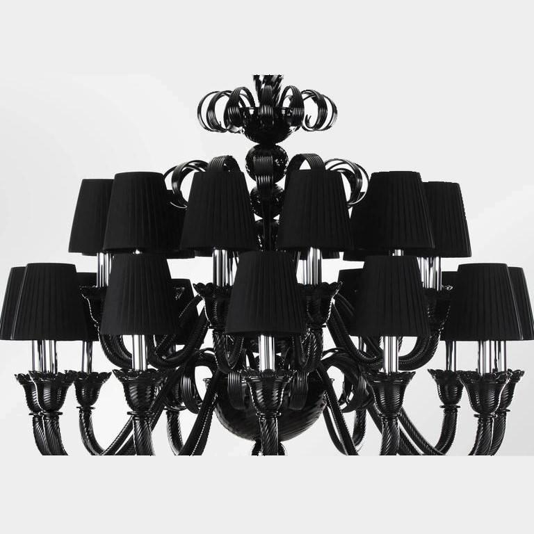 Italian Venetian chandelier shown in black Murano glass with twisted and straight ribs using Rigamena technique, with plisse lampshades 24 lights / E12 or E14 type / max 40W each   Diameter: 47 inches / Height: 43.5 inches Order Only / Made in Italy