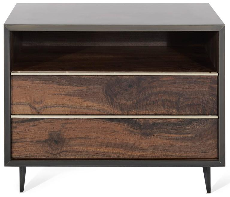 The elegant Henry end table has a darkened bronze encased in Epoxy Resin exterior with Claro walnut doors and interior and custom stingray leather pulls. The end table sits atop a blackened cold rolled steel base. The unique metal encased in resin