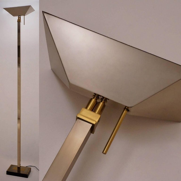Chrome & brass floor lamp with halogen uplighter by Deknudt Lighting, circa 1970s, Belgian.  This vintage floor lamp has been gently cleaned while respecting the antique patina. It is rewired, earthed & ready to use. This lamp is compatible with
