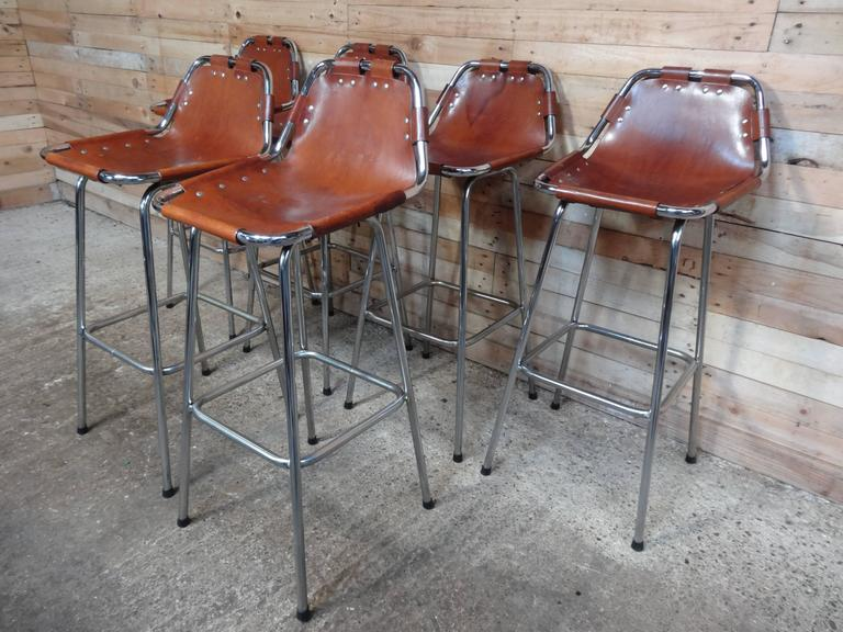 Stunning set of six stools, designer Charlotte Perriand used these in the Ski Resort Les Arcs, circa 1960. These stools were commissioned to be made by Cassina, one of the best Italian furniture maker's very nice chrome tubular frame with thick