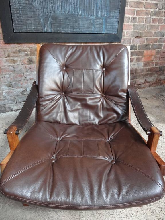 Stunning sling leather armchair designed by Torbjørn Afdal and made by Bruksbo in Norway, in great vintage condition and leather seat has been newly up-holstered.